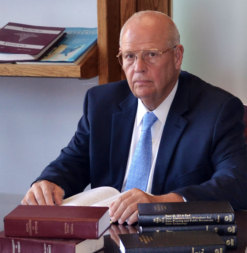 serious lawyer sitting in library with books